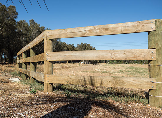 PERMAPoles as posts and flat timber as rails